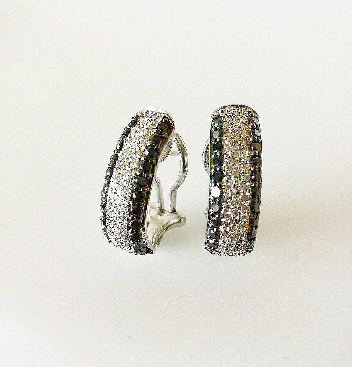 Black and white gold diamond earrings