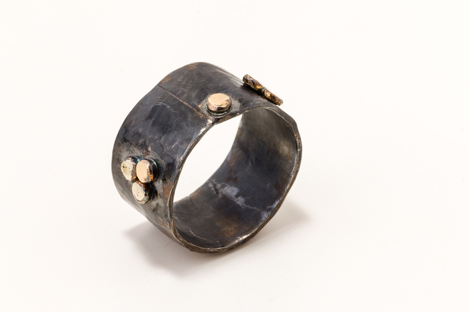 Blackened silver ring and gold